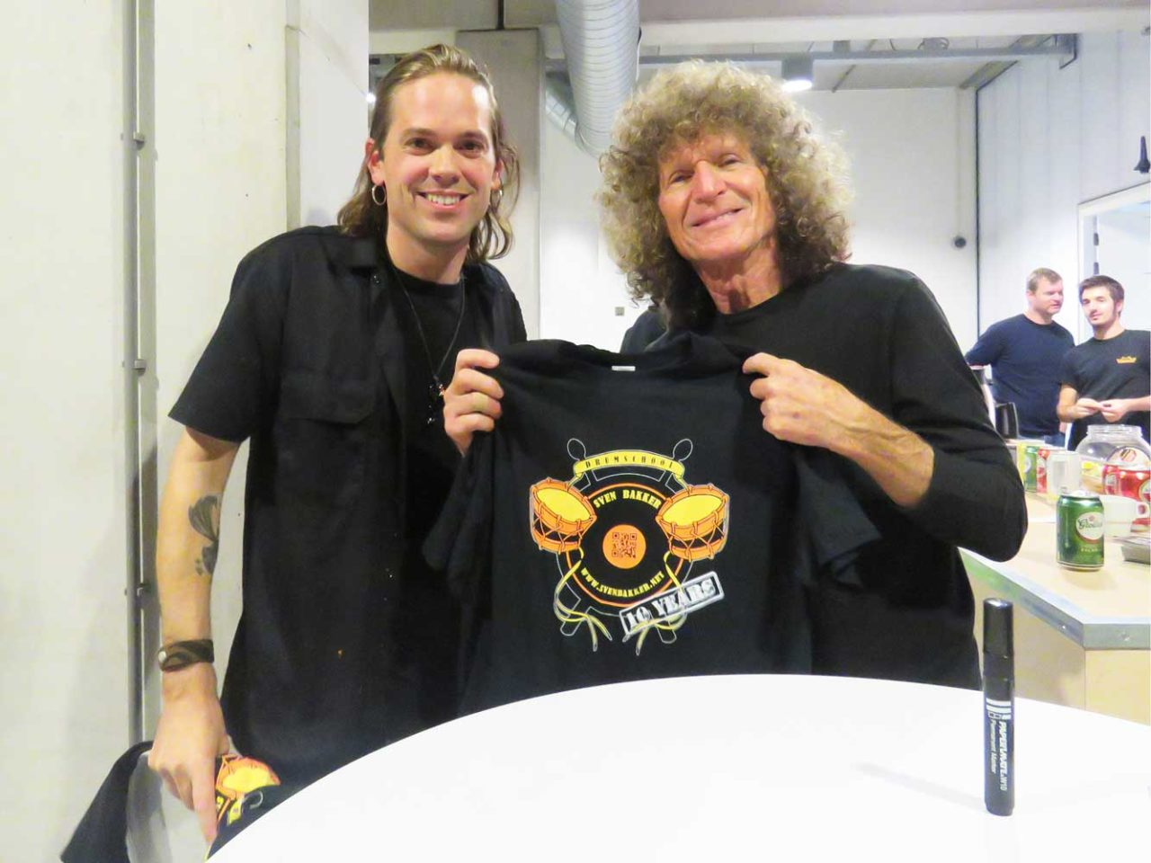 Tommy Aldridge with official shirt with logo 10 years  Drum school Sven Bakker